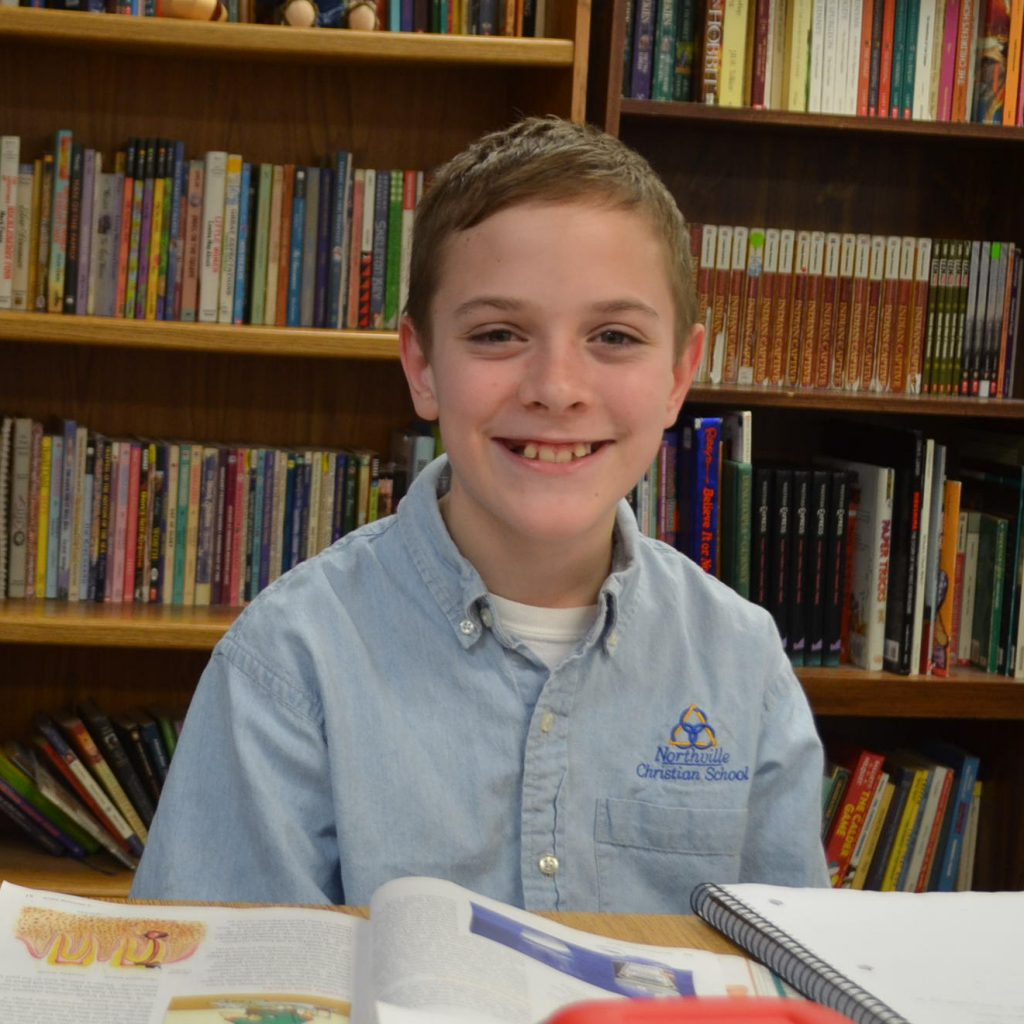 5TH Grader with books