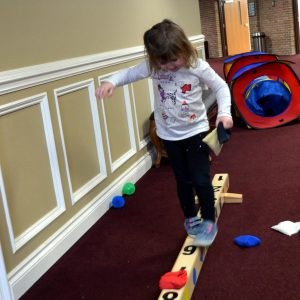 preschooler on balance board